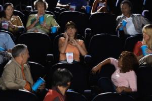 Woman Talking on Cell Phone During Movie